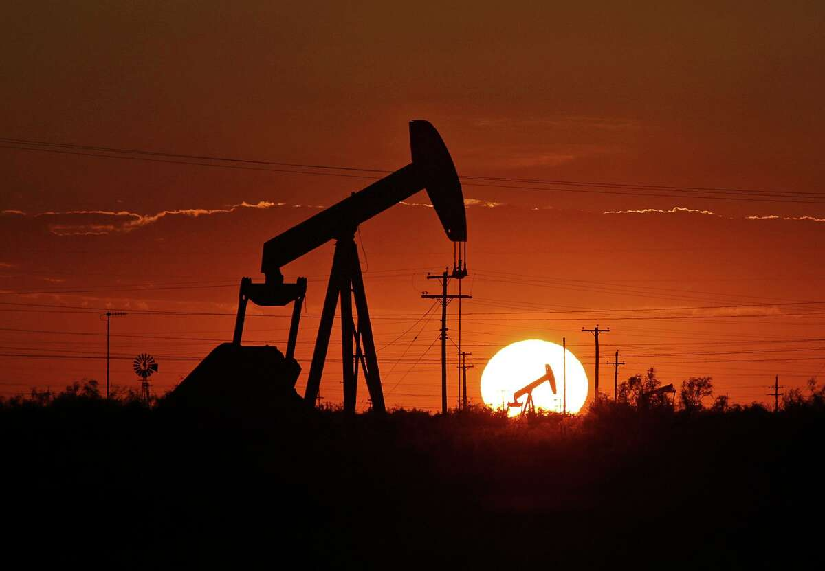 FILE - In this June 11, 2019, file photo a pump jack operates in an oil field in the Permian Basin in Texas. Energy stocks slipped on falling oil prices during the second quarter as global demand weakened and investors grew increasingly worried about economic growth. The costly trade war between the U.S. and China escalated during the quarter and the U.S. threatened to expand trade disputes to Mexico. That rattled investors who were dealing with an already volatile market and hoped for some kind of resolution. (Jacob Ford/Odessa American via AP, File)