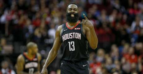 Houston Rockets guard James Harden (13) celebrates after scoring during the fourth quarter of an NBA game at the Toyota Center on Tuesday, Dec. 31, 2019, in Houston.