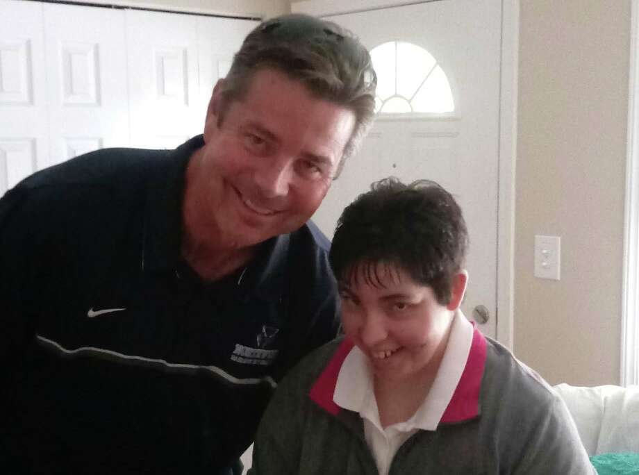 Heather Shauger poses with Northwood men's basketball coach Jeff Rekeweg at her home on Dec. 15, 2019, only a day before her passing. Photo: Photo Provided