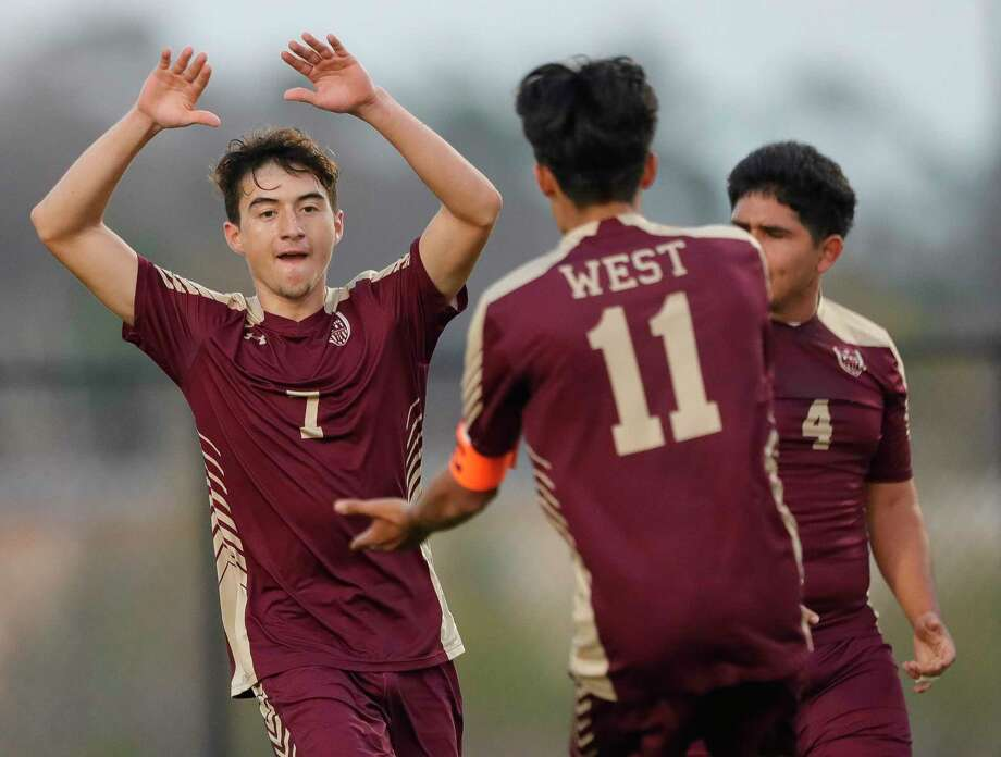 Magnolia West midfielder Norberto Trejo (7) gets a high-five from midfielder Carlos Larios (11) after heading the ball for a goal to tie the match 2-2 in the second period of a game during the Kilt Cup at Woodforest Bank Stadium, Friday, Jan. 3, 2020, in Shenandoah. Photo: Jason Fochtman, Houston Chronicle / Staff Photographer / Houston Chronicle © 2020