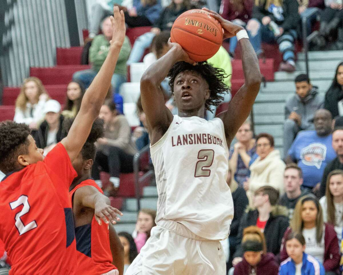 Lansingburgh senior Isaiah Knight takes a fade away jumper in front of Schenectady senior Naylon Carrington during a non-conference game at Lansingburgh High School on Friday, Jan. 3, 2020 (Jim Franco/Special to the Times Union.)