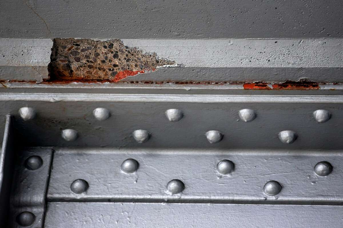 Exposed and broken concrete is visible on the underside of the Richmond-San Rafael Bridge in Richmond, Calif. on Tuesday, Dec. 31, 2019. State assemblyman Marc Levine is urging Caltrans consider rebuilding the aging span that links Marin and Contra Costa counties.