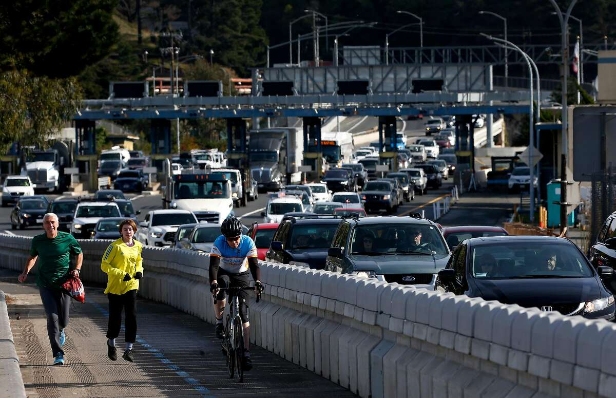 Traffic funnels into two westbound lanes after passing through the toll plaza and past a recently opened bicycle and pedestrian path on the Richmond-San Rafael Bridge in Richmond, Calif. on Tuesday, Dec. 31, 2019. State assemblyman Marc Levine is urging Caltrans consider rebuilding the aging span that links Marin and Contra Costa counties.
