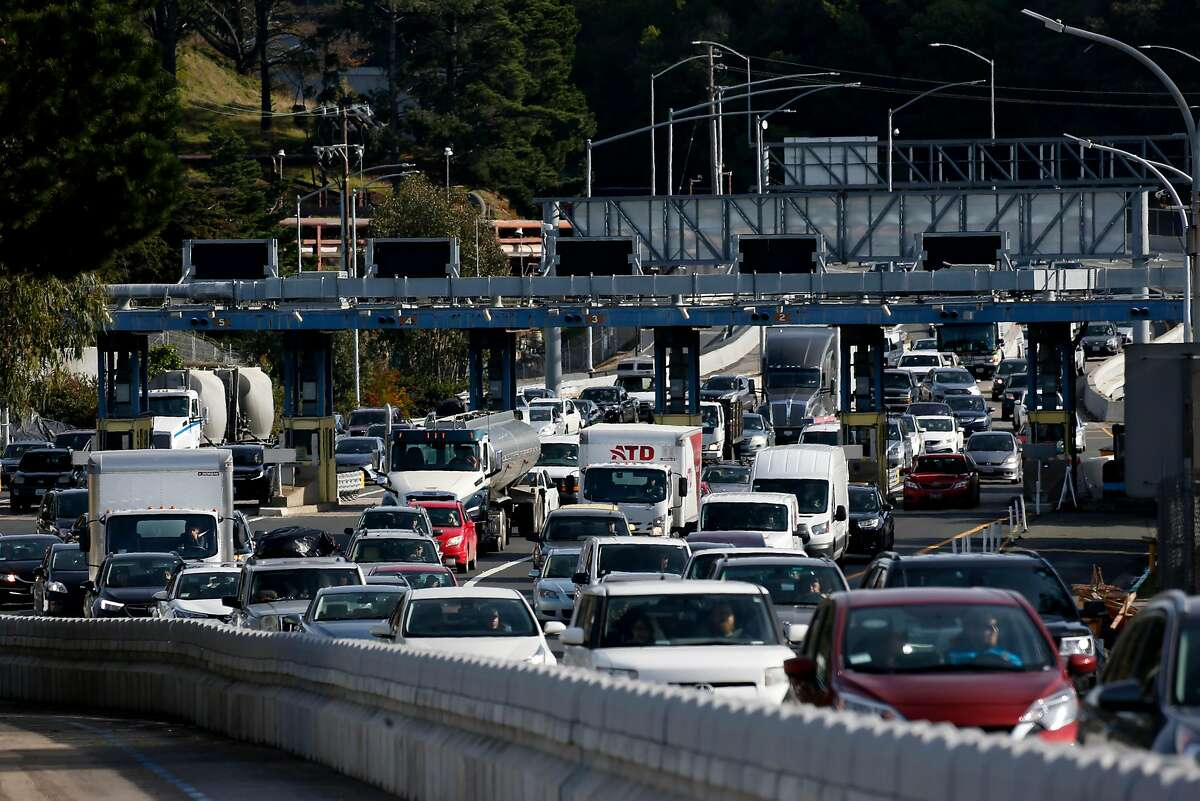 Traffic funnels into two westbound lanes after passing through the toll plaza on the Richmond-San Rafael Bridge in Richmond, Calif. on Tuesday, Dec. 31, 2019. State assemblyman Marc Levine is urging Caltrans consider rebuilding the aging span that links Marin and Contra Costa counties.