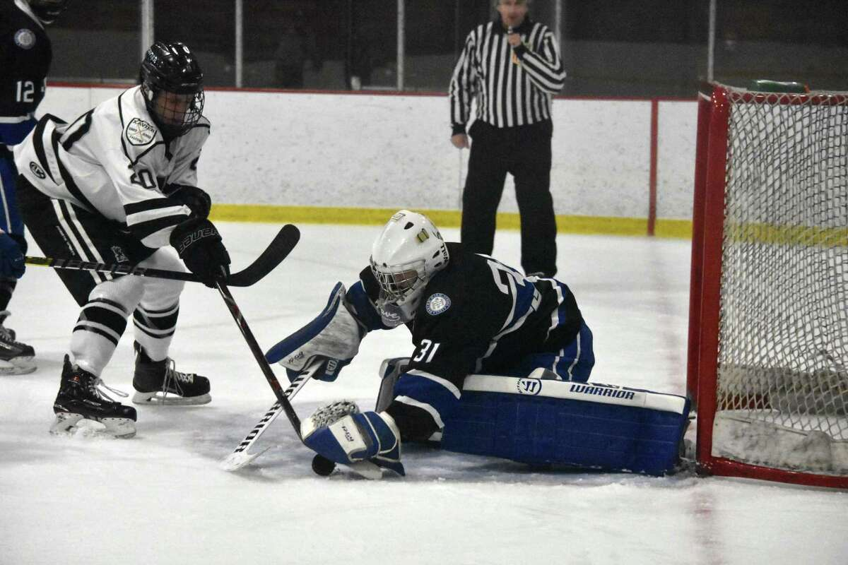 Darien's Chris Schofield makes a save against Xavier at the Snyder Rink at Wesleyan University on Friday.
