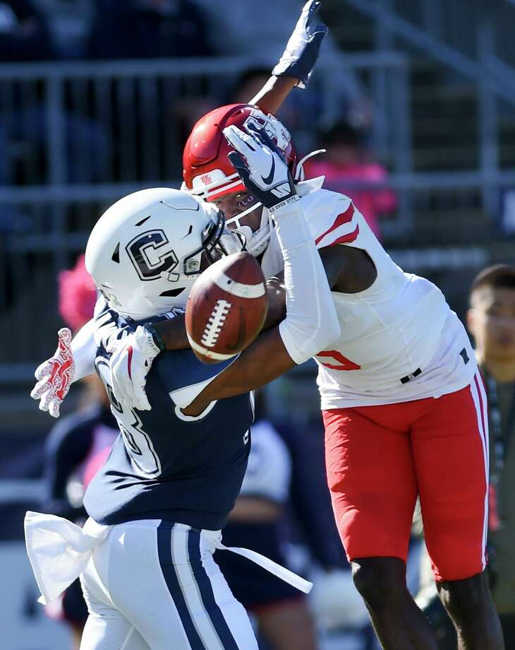 Connecticut defensive back Abiola Olaniyan (18) breaks up a pass intended for Houston wide receiver Marquez Stevenson (5) in the end zone during the first half of an NCAA college football game Oct. 19 in East Hartford. Photo: Stephen Dunn / Associated Press / Copyright 2019 The Associated Press. All rights reserved