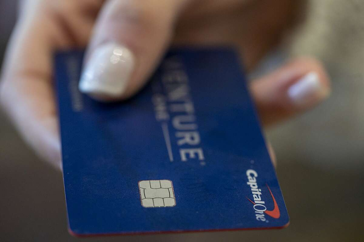 This Sunday, Aug. 11, 2019, photo shows a Capital One Venture card in New Orleans. (AP Photo/Jenny Kane)