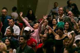 """Attendees pray before President Donald Trump speaks at an """"Evangelicals for Trump"""" campaign rally at the King Jesus International Ministry in Miami on Friday, Jan. 3, 2020. (Matias J. Ocner/Miami Herald/TNS)"""