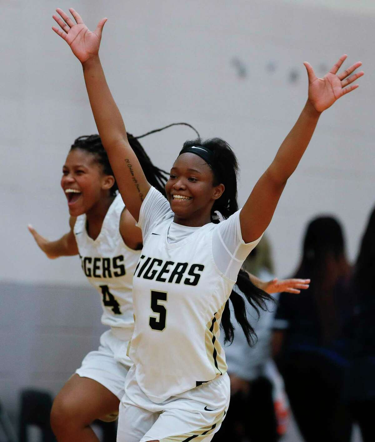 Conroe guards JaKayla Bradford (5) and Deanna Sneed (4) react after defeating Klein Collins 36-29 to stay atop District 15-6A at Conroe High School, Friday, Jan. 3, 2020, in Conroe.