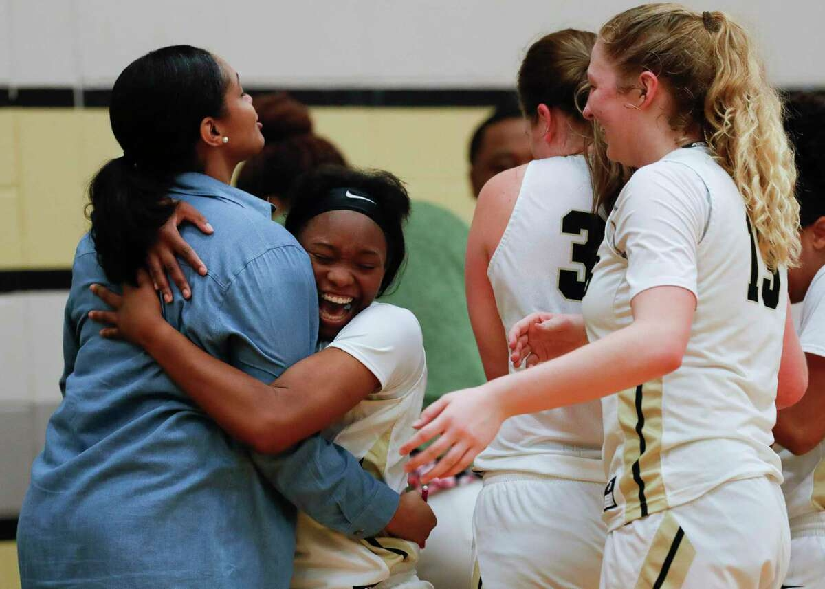 Conroe guard JaKayla Bradford (5) hugs head coach Tamisha Houston after defeating Klein Collins 36-29 to stay atop District 15-6A at Conroe High School, Friday, Jan. 3, 2020, in Conroe.