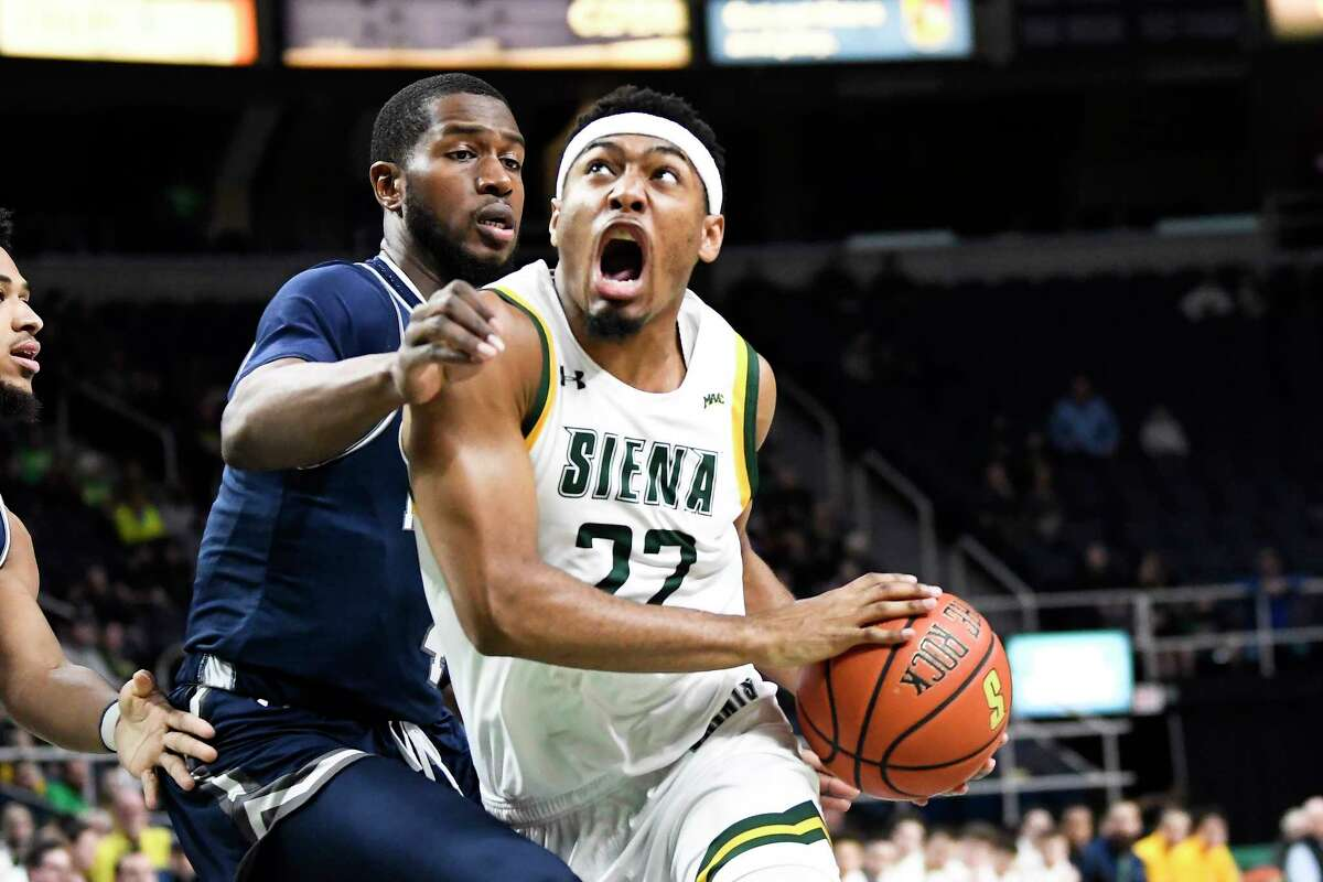 Siena guard Jalen Pickett (22) scores against Monmouth during the first half of an NCAA basketball game Friday, Jan. 3, 2020, in Albany, N.Y. (Hans Pennink / Special to the Times Union) ORG XMIT: 010420_siena_HP101