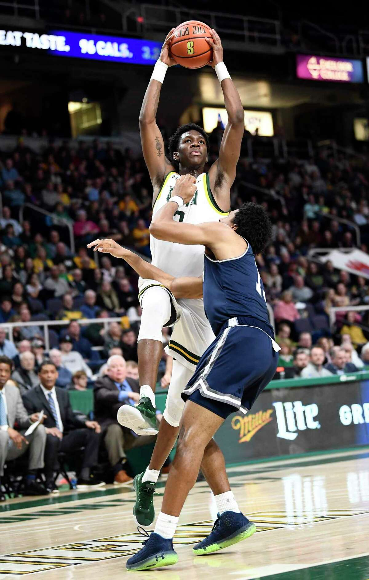 Siena guard Gary Harris Jr. (2) scores against Monmouth guard Marcus McClary (13) during the first half of an NCAA basketball game Friday, Jan. 3, 2020, in Albany, N.Y. (Hans Pennink / Special to the Times Union) ORG XMIT: 010420_siena_HP103