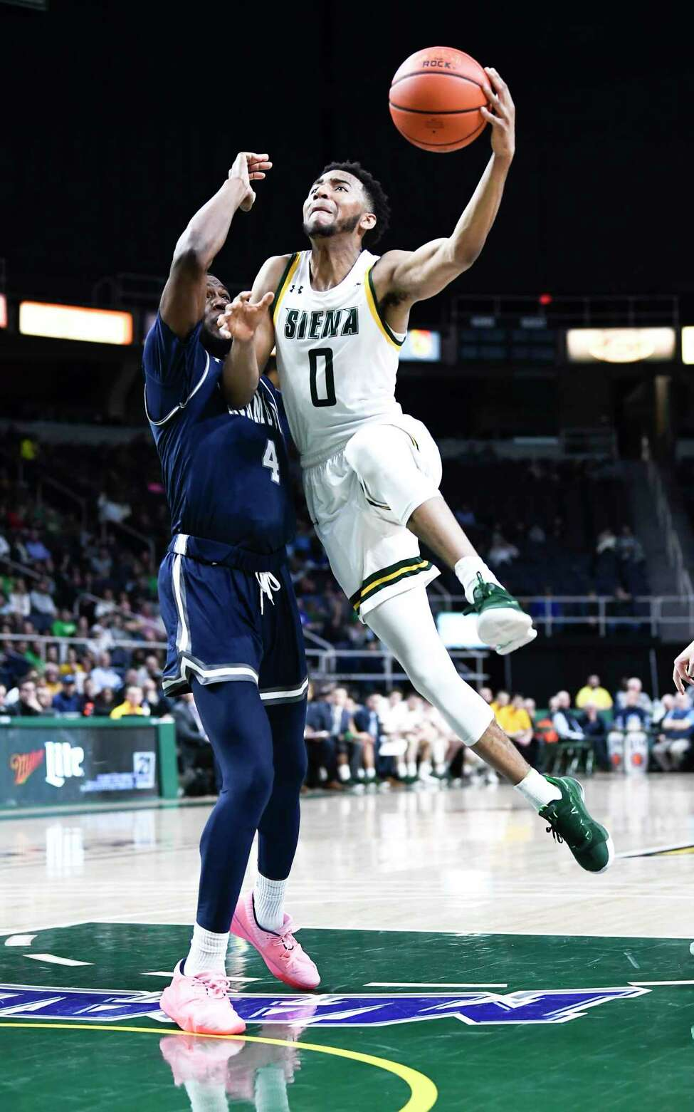 Siena guard Donald Carey (0) scores against Monmouth forward Mustapha Traore (4) during the first half of an NCAA basketball game Friday, Jan. 3, 2020, in Albany, N.Y. (Hans Pennink / Special to the Times Union) ORG XMIT: 010420_siena_HP104