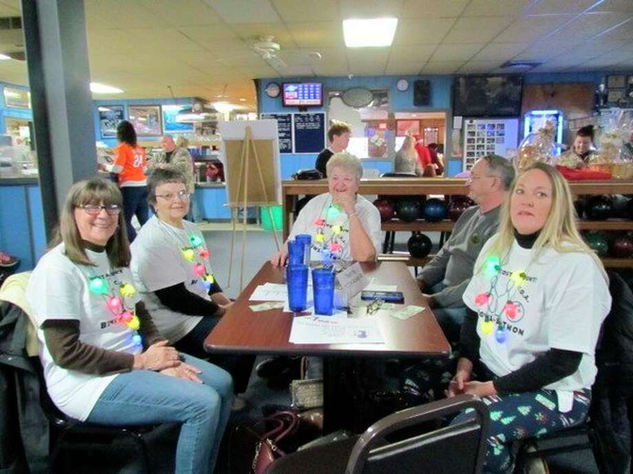A group of friends enjoy bowling during the Mecosta County Commission on Aging and Activity Center's Bowl-a-Thon. (Courtesy photo)