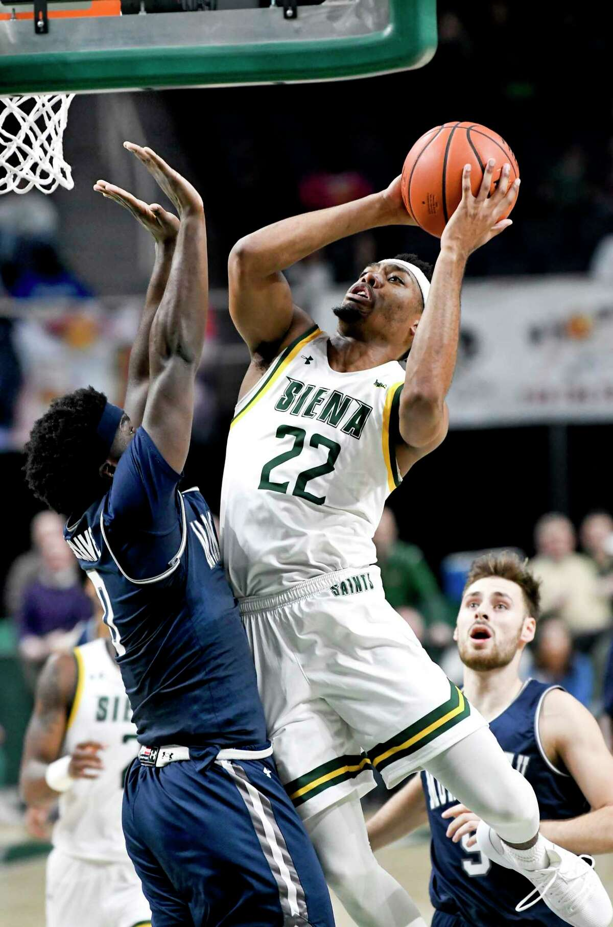 Siena guard Jalen Pickett (22) scores against Monmouth guard Ray Salnave (0) during the second half of an NCAA basketball game Friday, Jan. 3, 2020, in Albany, N.Y. Siena won 75-72. (Hans Pennink / Special to the Times Union) ORG XMIT: 010420_siena_HP107