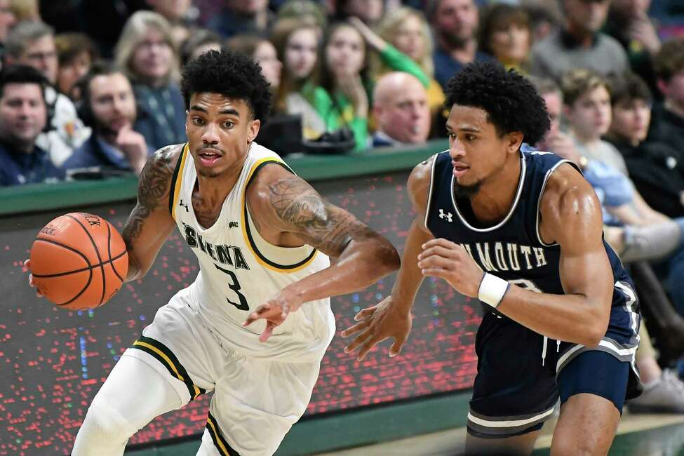 Siena guard Manny Camper (3) moves the ball past Monmouth guard Marcus McClary (13) during the second half of an NCAA basketball game Friday, Jan. 3, 2020, in Albany, N.Y. Siena won 75-72. (Hans Pennink / Special to the Times Union) ORG XMIT: 010420_siena_HP108