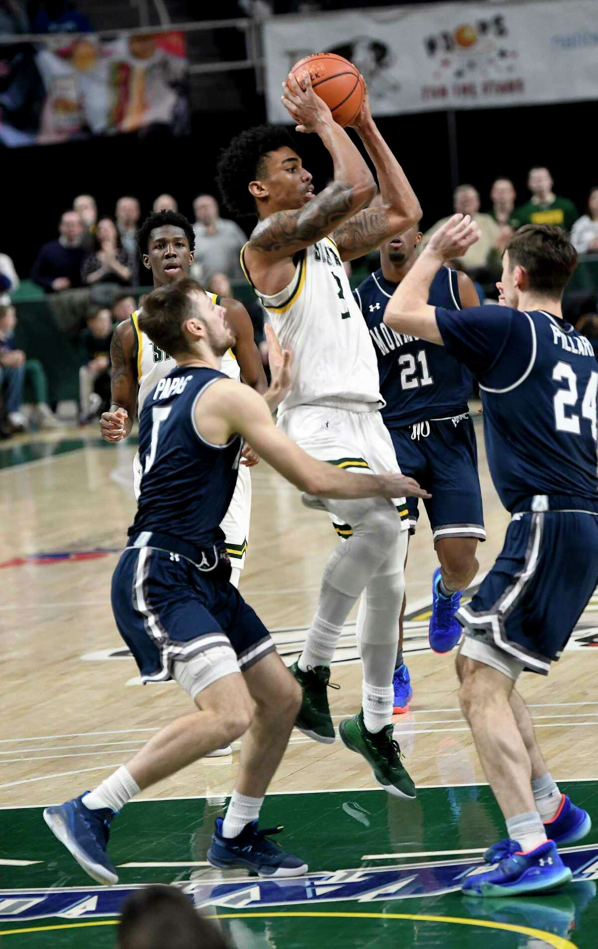Siena guard Manny Camper (3) scores against Monmouth during the second half of an NCAA basketball game Friday, Jan. 3, 2020, in Albany, N.Y. Siena won 75-72. (Hans Pennink / Special to the Times Union) ORG XMIT: 010420_siena_HP110