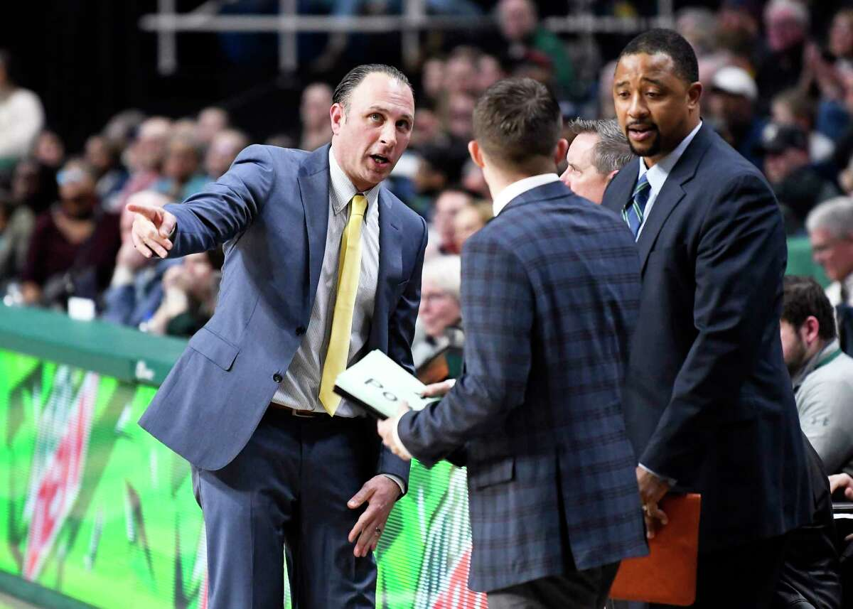 Siena head coach Carmen Maciariello ], left, talks with his coaching staff during the second half of an NCAA basketball game Friday, Jan. 3, 2020, in Albany, N.Y. Siena won 75-72. (Hans Pennink / Special to the Times Union) ORG XMIT: 010420_siena_HP111