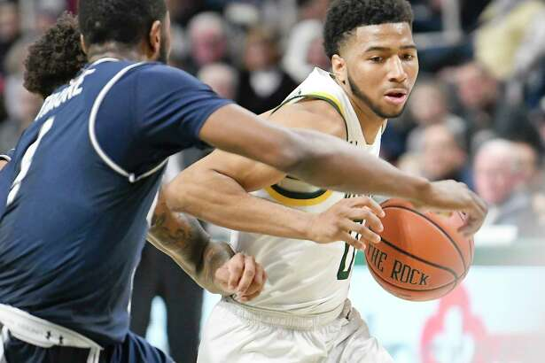 Siena guard Donald Carey (0) moves the ball against Monmouth during the second half of an NCAA basketball game Friday, Jan. 3, 2020, in Albany, N.Y. Siena won 75-72. (Hans Pennink / Special to the Times Union) ORG XMIT: 010420_siena_HP113