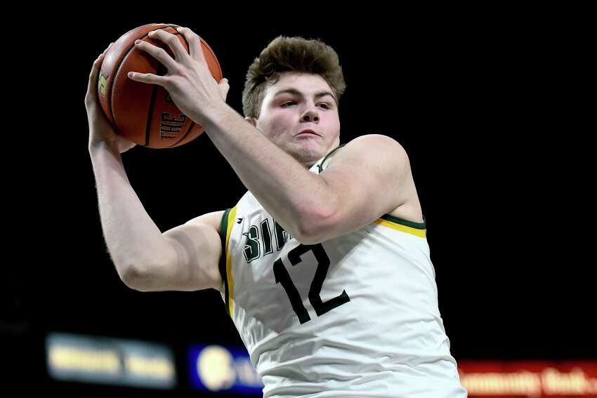 Siena forward Kyle Young (12) grabs a rebound against Monmouth during the first half of an NCAA basketball game Friday, Jan. 3, 2020, in Albany, N.Y. (Hans Pennink / Special to the Times Union) ORG XMIT: 010420_siena_HP114