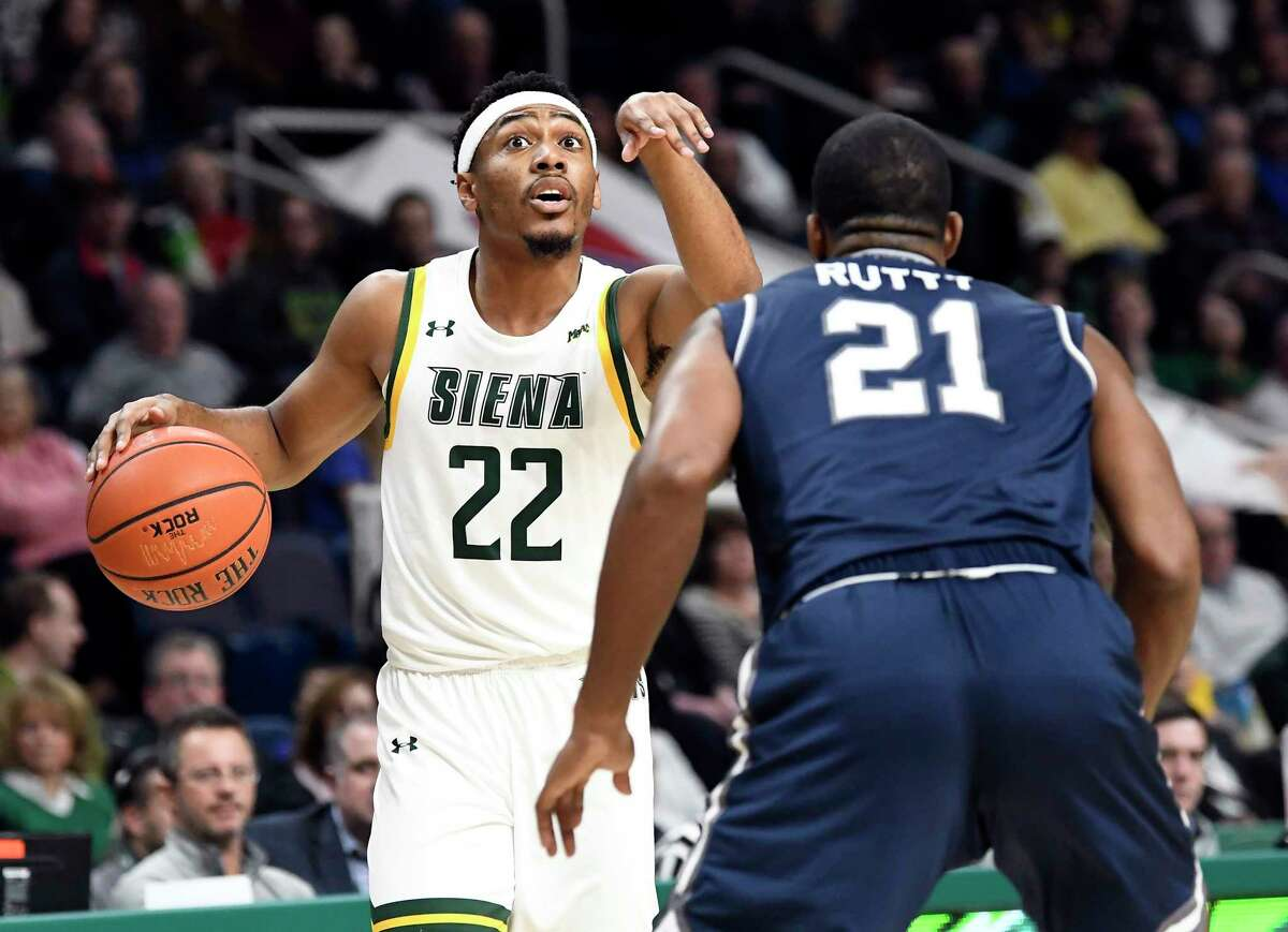 Siena guard Jalen Pickett (22) moves the ball against Monmouth forward Nikkei Rutty (21) during the first half of an NCAA basketball game Friday, Jan. 3, 2020, in Albany, N.Y. (Hans Pennink / Special to the Times Union) ORG XMIT: 010420_siena_HP116