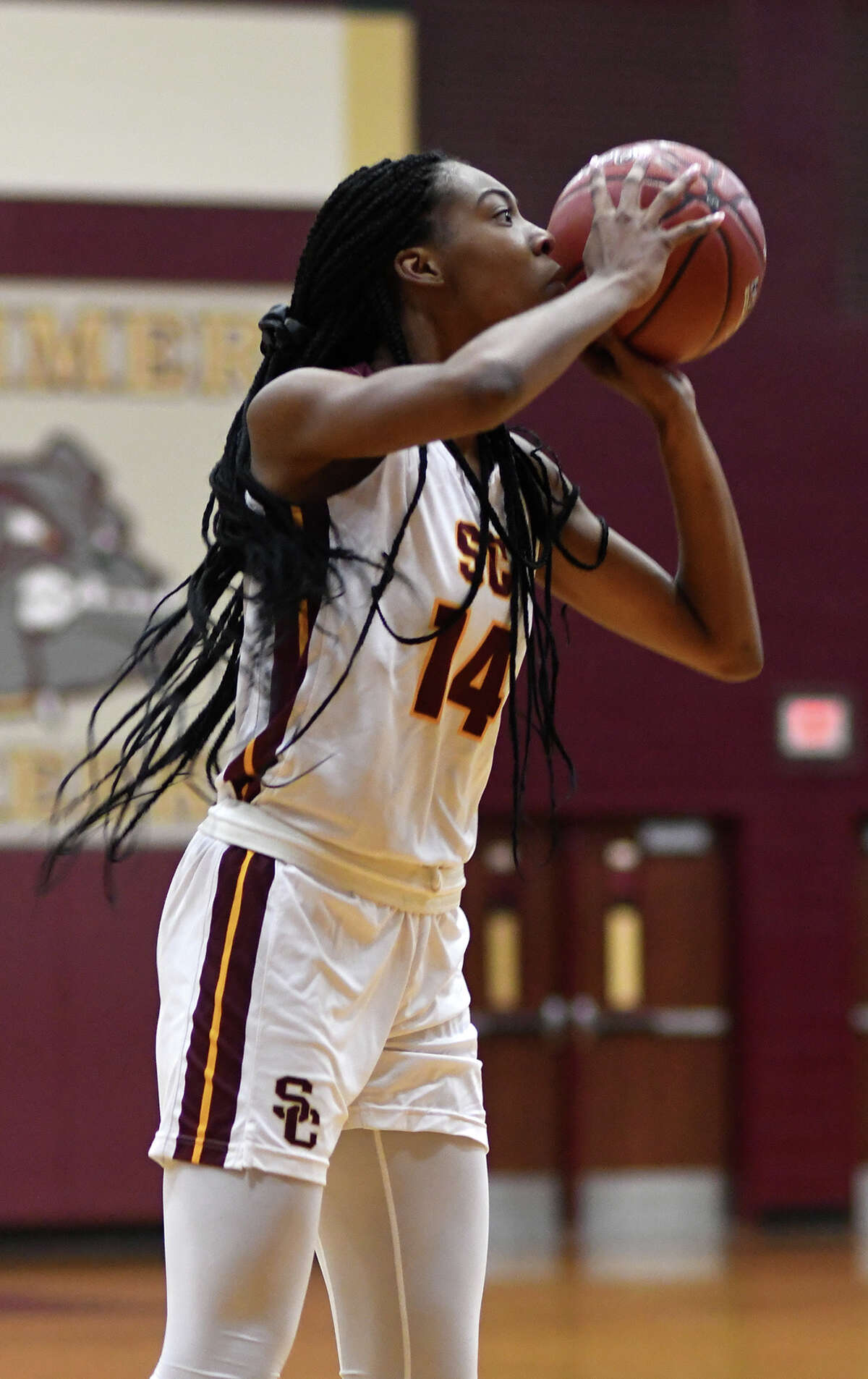 Summer Creek senior forward Maliyah Johnson sets for a shot against the Atascocita defense during the 1st quarter of their District 22-6A matchup at Summer Creek High School on Friday, Jan. 3, 2020.