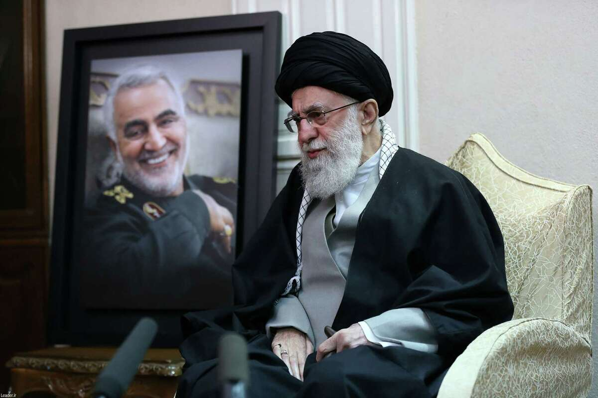 A handout picture provided by the office of Iran's Supreme Leader Ayatollah Ali Khamenei on January 3, 2020, shows him visiting the family of killed Iranian Revolutional Guards commander Qasem Soleimani (picture), in the capital Tehran. A furious Iran threatened to avenge a US strike that killed the top Iranian commander at Baghdad's international airport early in the morning, raising fears of a wider regional conflict between the arch-foes. To his fans and enemies alike, Soleimani was the key architect of Iran's regional influence, leading the fight against jihadist forces and extending Iran's diplomatic heft in Iraq.