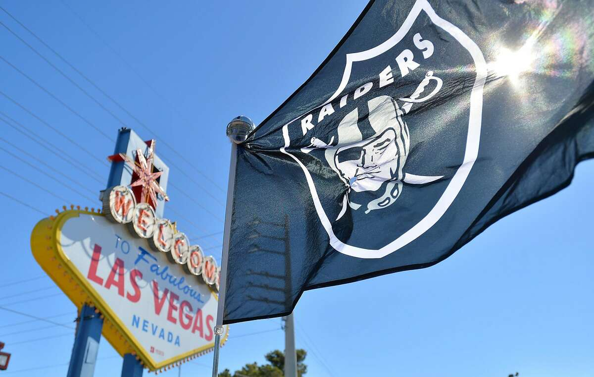 LAS VEGAS, NV - APRIL 29: An Oakland Raiders flag is shown during the team's 2017 NFL Draft event at the Welcome to Fabulous Las Vegas sign on April 29, 2017 in Las Vegas, Nevada. National Football League owners voted in March to approve the team's appli