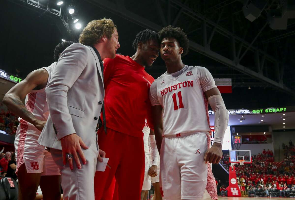 Houston Cougars guard Nate Hinton (11) celebrates with teammates after scoring a three-pointer against the UCF Knights during the second half of an NCAA game at the Fertitta Center Friday, Jan. 3, 2020, in Houston. The Cougars won 78-63.