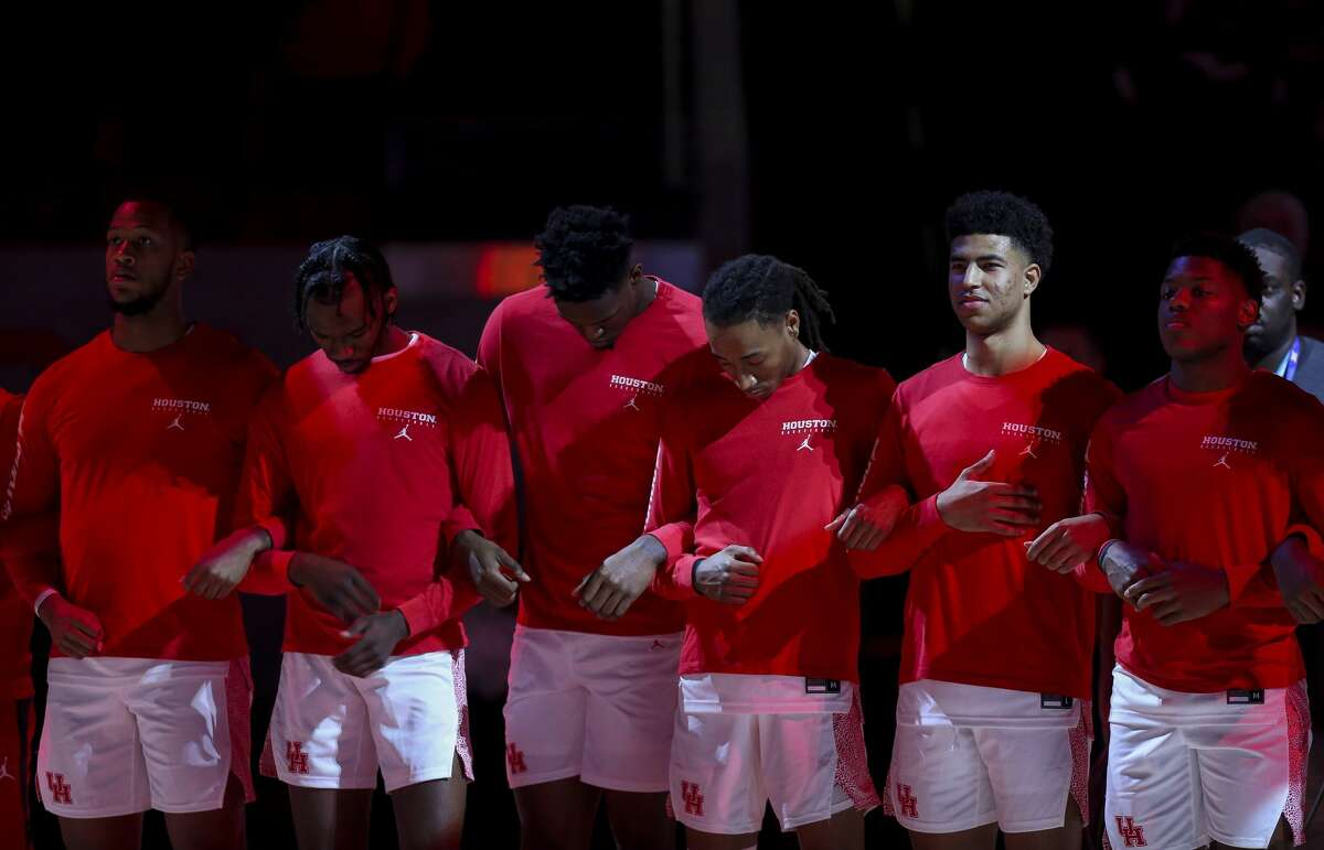 The Houston Cougars basketball team listens to the national anthem before an NCAA game against the UCF Knights at the Fertitta Center Friday, Jan. 3, 2020, in Houston.