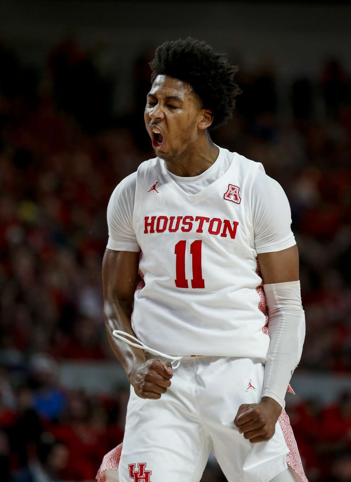 Houston Cougars guard Nate Hinton (11) celebrates after scoring to take the lead back against the UCF Knights during the first half of an NCAA game at the Fertitta Center Friday, Jan. 3, 2020, in Houston.