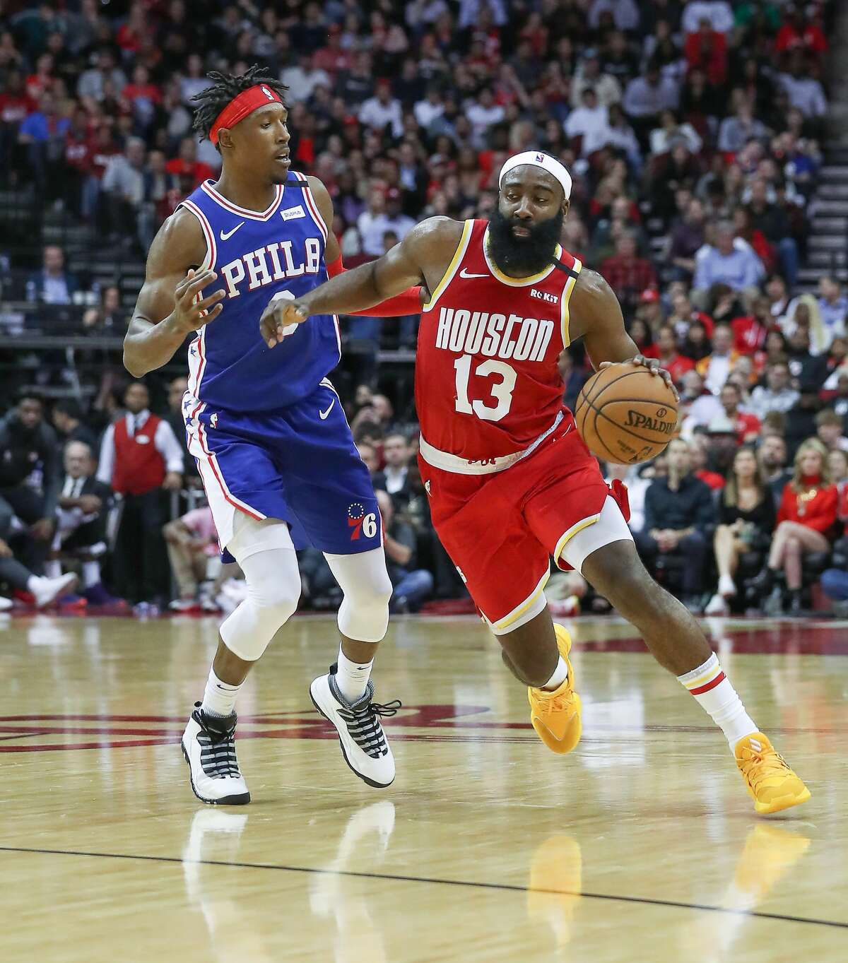 Houston Rockets guard James Harden (13) drives around Philadelphia 76ers guard Josh Richardson (0) during the 2nd half of an NBA basketball game at Toyota Center on Friday, Jan. 3, 2020, in Houston.