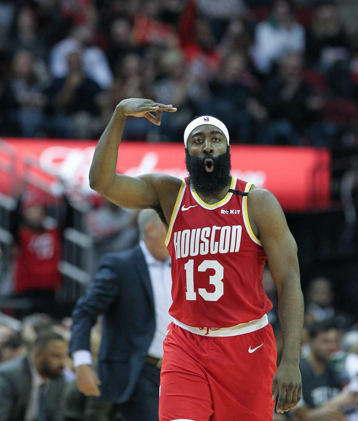 Houston Rockets guard James Harden (13) celebrates a three-pointer during the first half of an NBA basketball game at Toyota Center on Friday, Jan. 3, 2020, in Houston.
