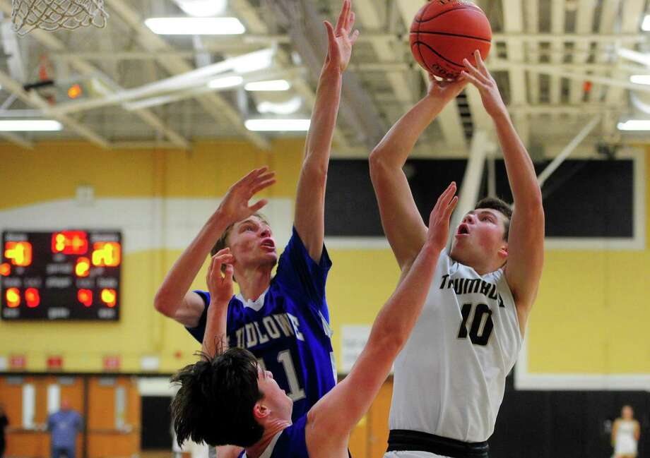 Trumbull's Connor Johnston looks to score as Ludlowe's Ian Bentley defends during the Eagles' 72-58 victory on Friday in Trumbull. Photo: Christian Abraham / Hearst Connecticut Media / Connecticut Post