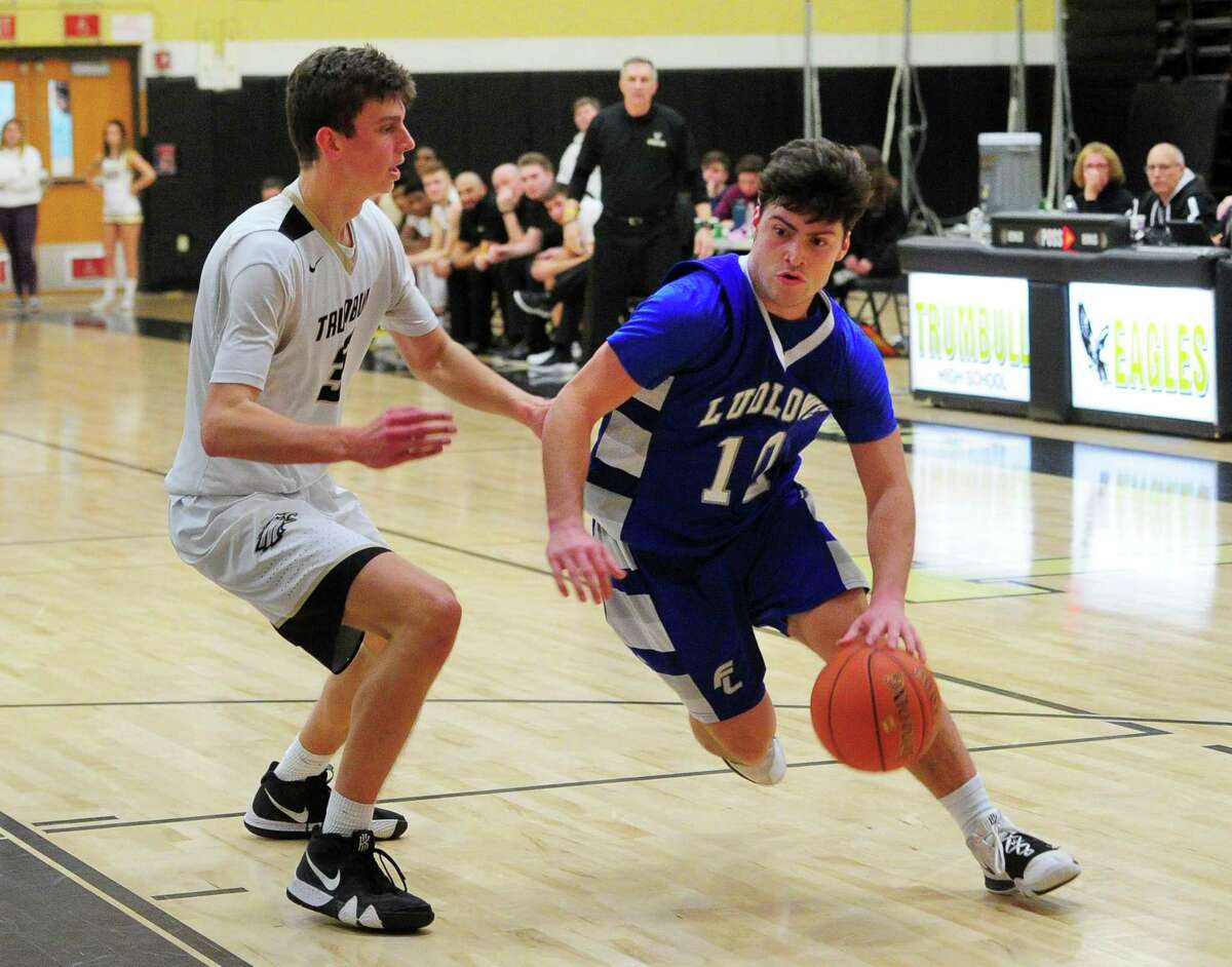 Fairfield Ludlowe's James Bourque (10) drive sthe ball towards the net past Trumbull's Andrew Cutter (33) during boys high school basketball in Trumbull, Conn., on Friday Jan. 3, 2020.