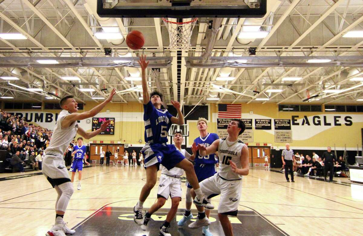Fairfield Ludlowe's Chris Carlucci (5) lays up the ball during boys high school basketball against Trumbull in Trumbull, Conn., on Friday Jan. 3, 2020.