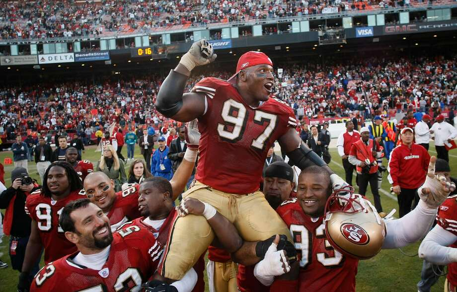 Bryant Young, shown being carried off the field by teammates in 2007, will be inducted into the team's Hall of Fame. Photo: Michael Macor / SFC