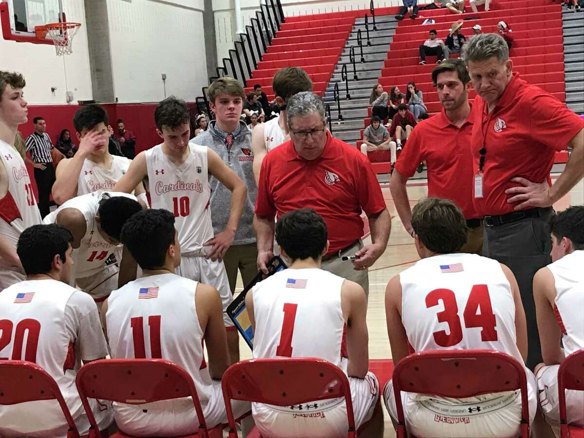 Greenwich boys basketball coach Chris Lovermi addresses his team during the closing minutes of their game against visiting Ridgefield on Friday, January 3, 2020. Ridgefield registered a 64-45 win.