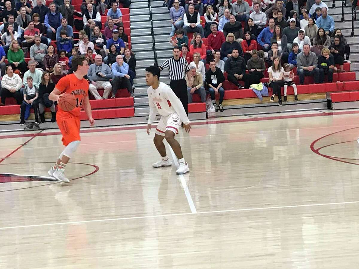 Ridgefield senior forward Christopher Knachel, left, scored a game-high 24 points in the Tigers' 64-45 win vs. Greenwich on Friday, January 3, 2020, in Greenwich.