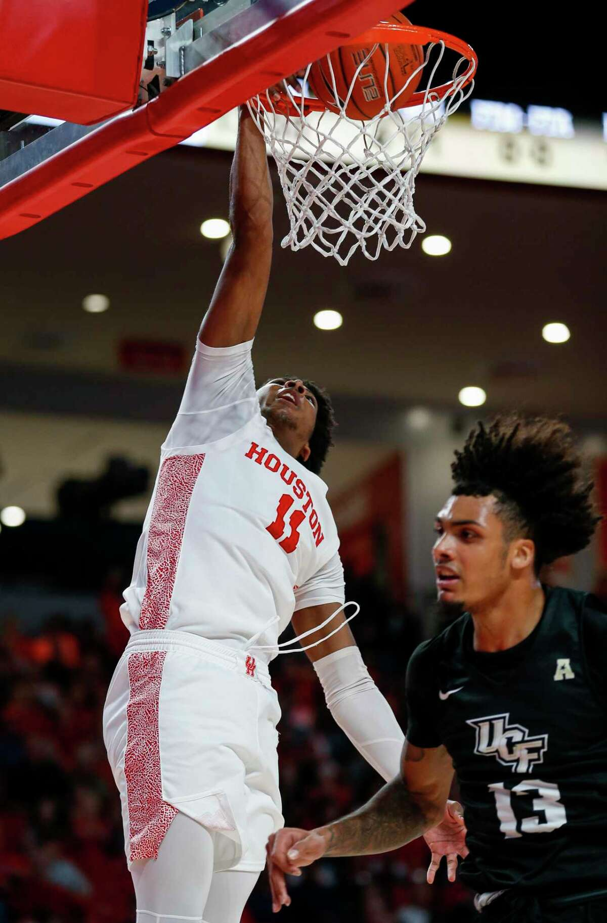 Houston Cougars guard Nate Hinton (11) dunks the ball to take the lead back against the UCF Knights during the first half of an NCAA game at the Fertitta Center Friday, Jan. 3, 2020, in Houston.