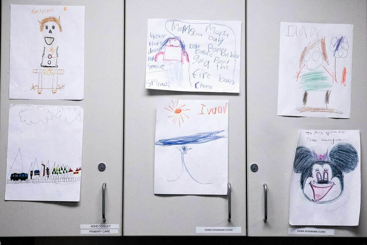 Drawings by child patients of Dr. Dayna Long and Dr. Neeta Thakur hang in their employee lounge at UCSF Benioff Children's Hospital Claremont Clinic East in Oakland , Calif. Friday, Jan. 3, 2020.