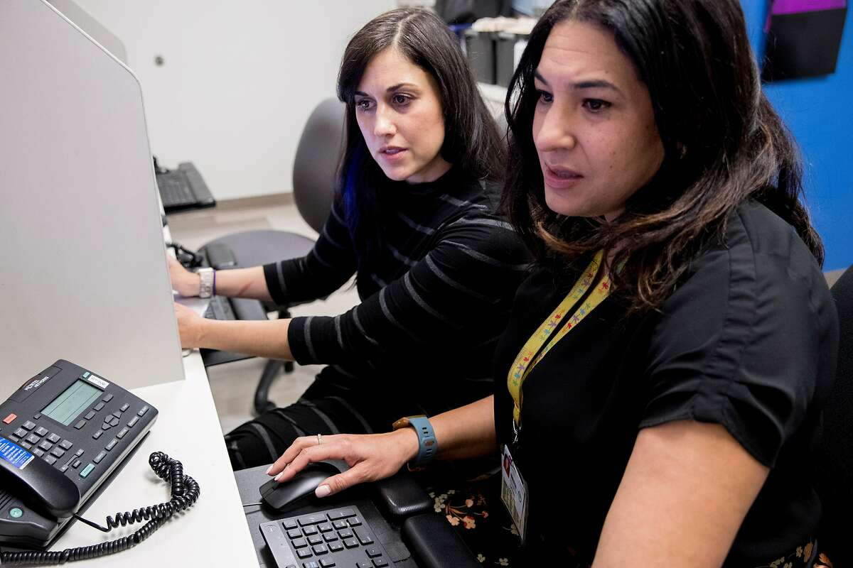 Dr. Dayna Long (right) and Dr. Neeta Thakur talk over data points in a newly developed screening tool used to identify trauma in children while at UCSF Benioff Children's Hospital Claremont Clinic East in Oakland , Calif. Friday, Jan. 3, 2020.