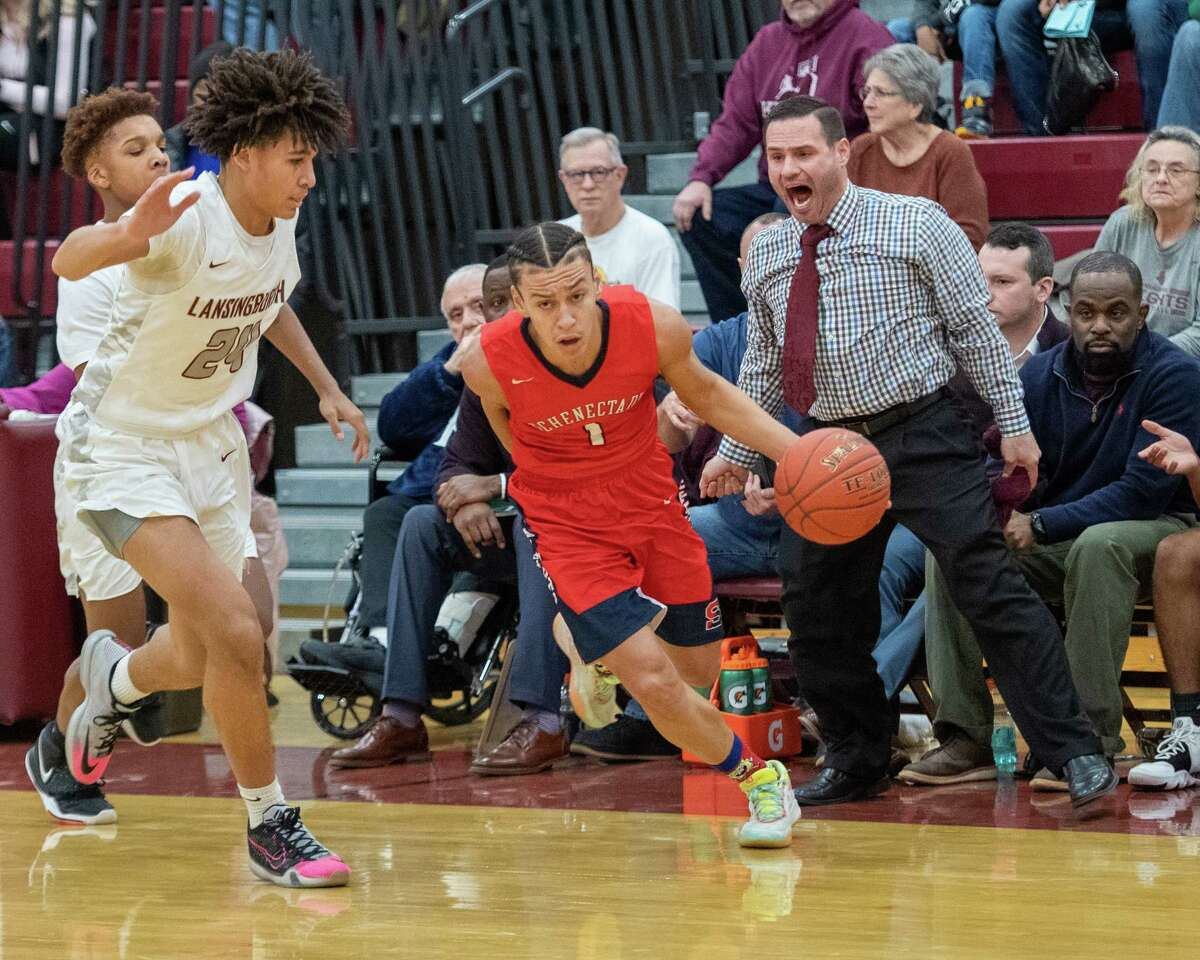 Schenectady senior Anthony Harris drives to the basket in front of Lansingburgh senior Kobi Wallace and head coach Eric Loudis during a non-conference game at Lansingburgh High School on Friday, Jan. 3, 2020 (Jim Franco/Special to the Times Union.)