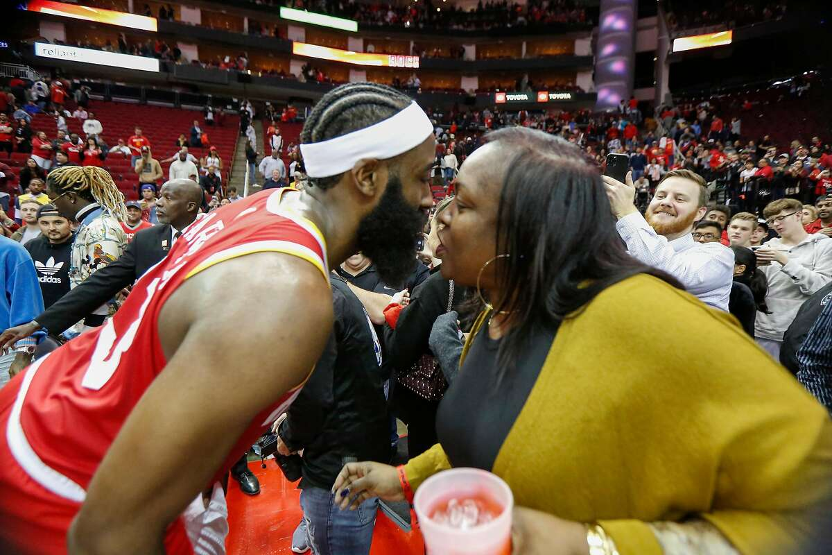 Houston Rockets guard James Harden (13) kisses his mother, Monja Willis after defeating the Philadelphia 76ers during an NBA basketball game at Toyota Center on Friday, Jan. 3, 2020, in Houston.