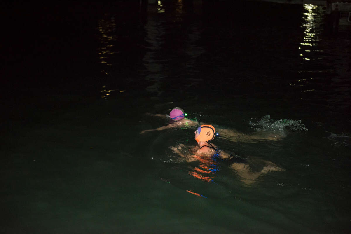 Tessa McLean, partners up with Lolly Lewis, a Dolphin Club member for the last 13 years, for an early morning swim (5 a.m. to be exact).
