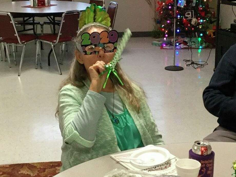 Seniors enjoyed an early celebration with friends Dec. 30 at the senior center, including a countdown to noon. (Courtesy Photo)