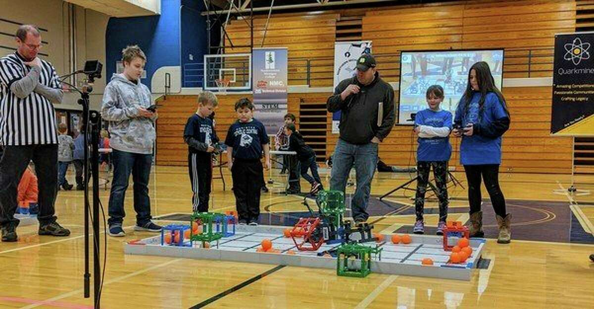 Manistee Catholic Central Robotics Club members Reid Kieszkowski and Logan Harvey are shown competing at the Kalkaska Elementary/Middle School competition. The pair won a second place finish with the things they could accomplish with their robot. (Courtesy photo)