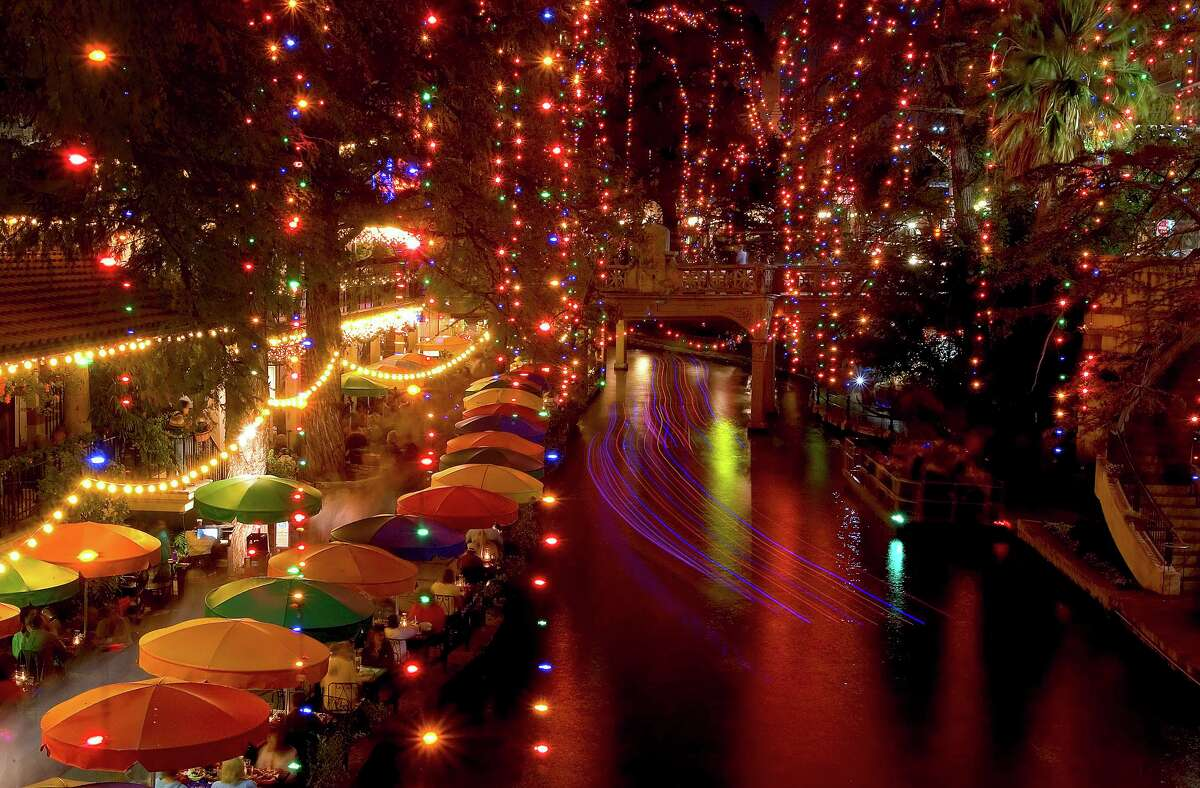Colorful holiday lights illuminate the River Walk.