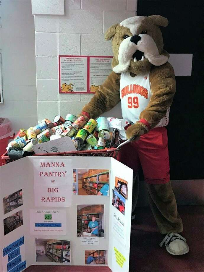 Ferris State University mascot Brutus smiles at the 307 pounds of canned goods Manna Pantry of Big Rapids received during Thursday night's basketball game. (Courtesy photo)