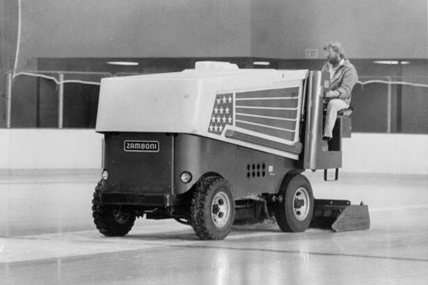 Driver Dave Howard guides the Zamboni ice resurfacer over one of the two rinks at Midland Civic Arena. November 1979
